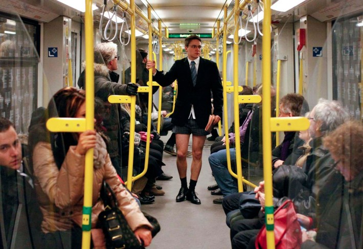 """Passengers look at a man without his pants on the subway during the """"No Pants Subway Ride"""" in Berlin"""